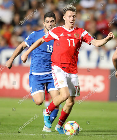 Aleksandr Golovin (Fr) of Russia and Ioannis Kousoulos (Bc) of Cyprus in action during the UEFA EURO 2020, Group I qualifying soccer match between Cyprus and Russia at the GSP stadium in Nicosia, Cyprus, 13 October 2019.