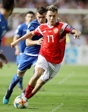 Aleksandr Golovin (Fr) of Russia and Kostakis Artymatas (Bc) of Cyprus in action during the UEFA EURO 2020, Group I qualifying soccer match between Cyprus and Russia at the GSP stadium in Nicosia, Cyprus, 13 October 2019.