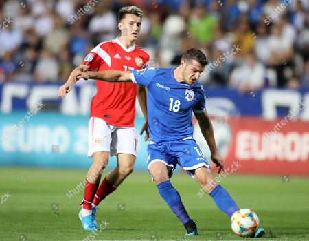 Kostakis Artymatas (R) of Cyprus and Aleksandr Golovin (L) of Russia in action during the UEFA EURO 2020, Group I qualifying soccer match between Cyprus and Russia at the GSP stadium in Nicosia, Cyprus, 13 October 2019.
