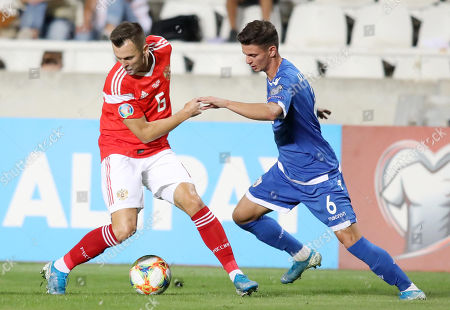 Denis Cheryshev (L) of Russia and Michalis Ioannou (R) of Cyprus in action during the UEFA EURO 2020, Group I qualifying soccer match between Cyprus and Russia at the GSP stadium in Nicosia, Cyprus, 13 October 2019.