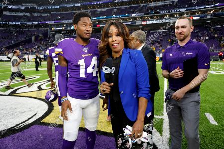 Fox Sports reporter Pam Oliver interviews Minnesota Vikings wide receiver Stefon Diggs, left, after an NFL football game between the Vikings and the Philadelphia Eagles, in Minneapolis. The Vikings won 38-20