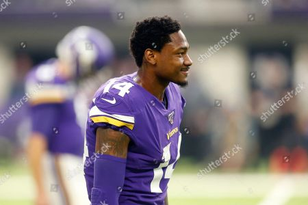Minnesota Vikings wide receiver Stefon Diggs walks on the field during the first half of an NFL football game against the Philadelphia Eagles, in Minneapolis