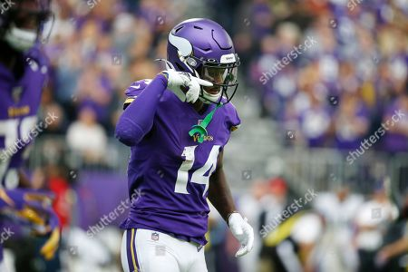 Minnesota Vikings wide receiver Stefon Diggs celebrates after catching a touchdown pass during the first half of an NFL football game against the Philadelphia Eagles, in Minneapolis