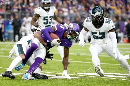 Minnesota Vikings wide receiver Stefon Diggs (14) catches a pass in front of Philadelphia Eagles inside linebacker Zach Brown, right, during the first half of an NFL football game, in Minneapolis