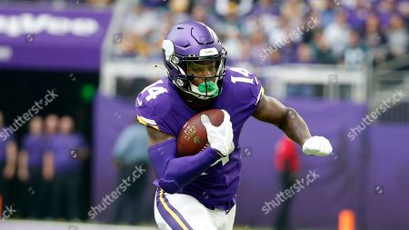 Minnesota Vikings wide receiver Stefon Diggs runs up field during the first half of an NFL football game against the Philadelphia Eagles, in Minneapolis