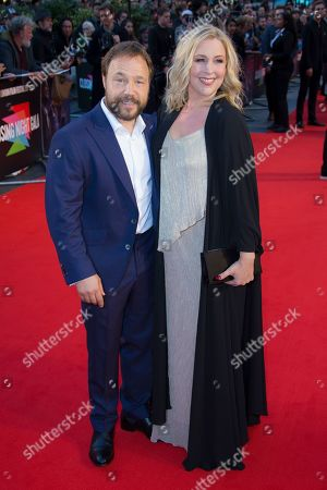Stephen Graham, Hannah Walters. Actor Stephen Graham and Hannah Walters pose for photographers upon arrival at the premiere of the film 'The Irishman' as part of the London Film Festival, in central London