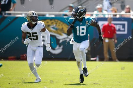 Jacksonville Jaguars wide receiver Chris Conley (18) runs a pass pattern in front of New Orleans Saints cornerback Eli Apple (25) during the first half of an NFL football game, in Jacksonville, Fla