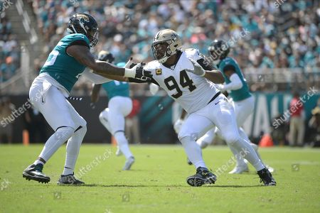 Jacksonville Jaguars offensive tackle Jawaan Taylor, left, blocks New Orleans Saints defensive end Cameron Jordan (94) during the first half of an NFL football game, in Jacksonville, Fla