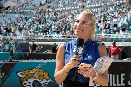 CBS television sideline reporter Melanie Collins works from the sideline before an NFL football game between the Jacksonville Jaguars and the New Orleans Saints, in Jacksonville, Fla