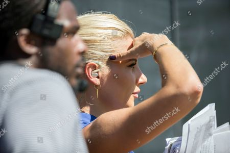 CBS television sideline reporter Melanie Collins works from the sideline during the second half of an NFL football game between the Jacksonville Jaguars and the New Orleans Saints, in Jacksonville, Fla