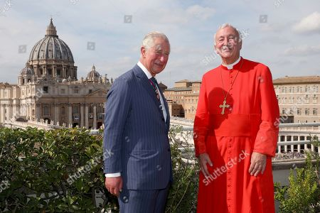 Stock Photo of Prince Charles and Archbishop of Westminster and President of the Catholic Bishops' Conference of England and Wales Vincent Gerard Nichols pose in front the St. Peter's Basilica during a reception for the Cardinal Newman Canonization at Pontifical Urban College, in Vatican City, Vatican. Pope Francis on Sunday canonized Cardinal John Henry Newman, the 19th-century Anglican convert who became an immensely influential, unifying figure in both the Anglican and Catholic churches