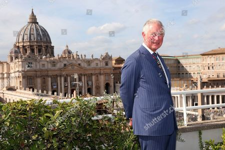 Britain's Prince Charles poses in front the St. Peter's Basilica during a reception for the Cardinal Newman Canonization at Pontifical Urban College, in Vatican City, Vatican. Pope Francis on Sunday canonized Cardinal John Henry Newman, the 19th-century Anglican convert who became an immensely influential, unifying figure in both the Anglican and Catholic churches