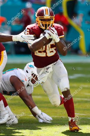 Washington Redskins running back Adrian Peterson (26) runs the ball, during the second half at an NFL football game against the Miami Dolphins, in Miami Gardens, Fla