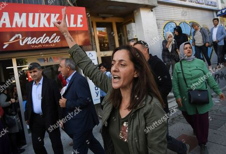 A pro-Kurdish party member shouts slogans to protest against Turkey's military operation in Syria, in Istanbul, . Turkey's President Recep Tayyip Erdogan has rejected offers for mediation with Syrian Kurdish fighters as the Turkish military continues its offensive against them in northern Syria