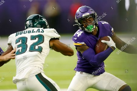 Stefon Diggs, Rasul Douglas. Minnesota Vikings wide receiver Stefon Diggs (14) runs from Philadelphia Eagles cornerback Rasul Douglas (32) during the first half of an NFL football game, in Minneapolis