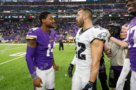 Minnesota Vikings wide receiver Stefon Diggs, left, talks with Philadelphia Eagles strong safety Andrew Sendejo after an NFL football game, in Minneapolis