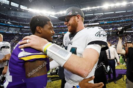 Stock Picture of Minnesota Vikings wide receiver Stefon Diggs, left, talks with Philadelphia Eagles quarterback Carson Wentz after an NFL football game, in Minneapolis