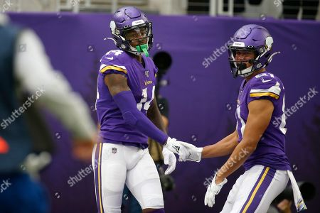 Stock Photo of Minnesota Vikings wide receiver Stefon Diggs, left, celebrates with teammate Bisi Johnson, right, after catching a 51-yard touchdown pass during the first half of an NFL football game against the Philadelphia Eagles, in Minneapolis