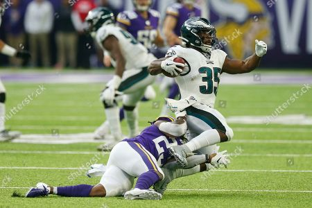 Mike Boone, Orlando Scandrick. Philadelphia Eagles' Orlando Scandrick (35) is tackled by Minnesota Vikings' Mike Boone, left, during the second half of an NFL football game, in Minneapolis
