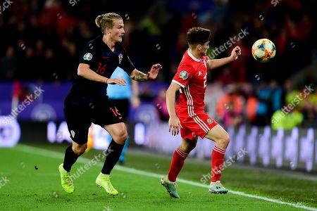 Tin Jedvaj of Croatia marks Daniel James of Wales