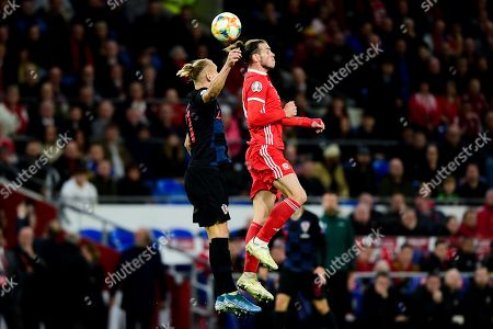 Gareth Bale of Wales contends for the aerial ball with Tin Jedvaj of Croatia
