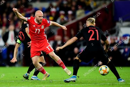 Jonny Williams of Wales is challenged by Domagoj Vida of Croatia