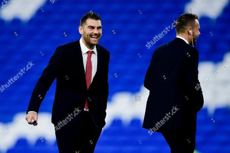 Sam Vokes laughs with Chris Gunter of Wales prior to kick off