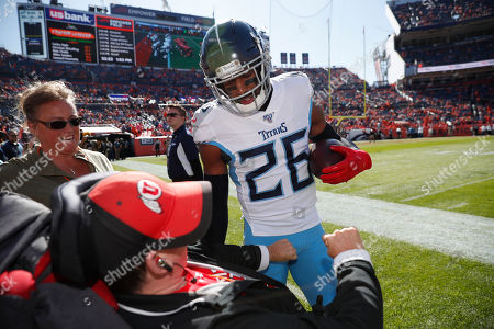 Stock Picture of Tennessee Titans cornerback Adoree' Jackson spends some time with a fan in a wheelchair before an NFL football game against the Denver Broncos, in Denver