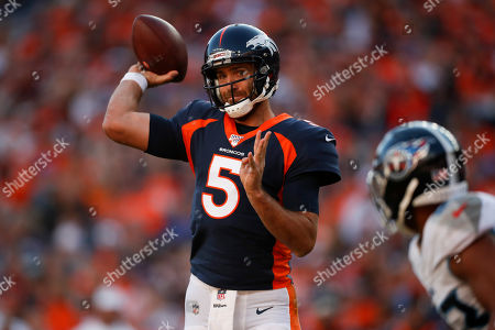 Denver Broncos quarterback Joe Flacco throws a pass during the second half of an NFL football game against the Tennessee Titans, in Denver