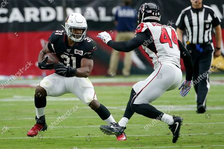 Stock Image of Arizona Cardinals running back David Johnson (31) runs as Atlanta Falcons defensive end Vic Beasley (44) pursues during the first half of an NFL football game, in Glendale, Ariz