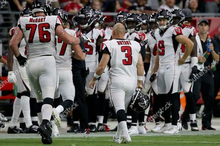 Atlanta Falcons kicker Matt Bryant (3) walls to his bench after missing the point after against the Arizona Cardinals during the second half of an NFL football game, in Glendale, Ariz