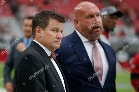 Arizona Cardinals president Michael Bidwill and general manager Steve Keim watch prior to an NFL football game against the Atlanta Falcons, in Glendale, Ariz