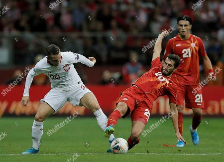 Stock Image of Poland's Piotr Zielinski (L) and Stefan Spirovski (R) and North Macedonia in action during the UEFA EURO 2020 group G qualifying soccer match between Poland and North Macedonia at PGE National stadium in Warsaw, Poland, Poland, 13 October 2019.