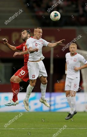 Stock Photo of Poland's Jacek Goralski (R) and Goran Pandev (L) and North Macedonia in action during the UEFA EURO 2020 group G qualifying soccer match between Poland and North Macedonia at PGE National stadium in Warsaw, Poland, Poland, 13 October 2019.