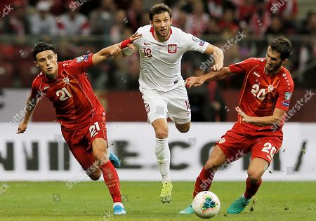 Stock Photo of Poland's Bartosz Bereszynski (C) and Stefan Spirovski (R) and Elif Elmas (L) and North Macedonia in action during the UEFA EURO 2020 group G qualifying soccer match between Poland and North Macedonia at PGE National stadium in Warsaw, Poland, Poland, 13 October 2019.