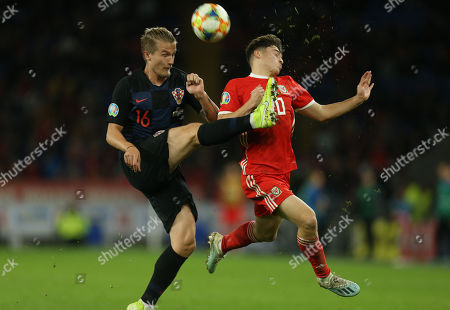 Tin Jedvaj of Croatia clears the ball as Daniel James of Wales challenges