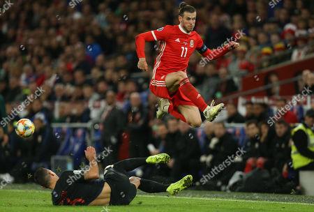 Stock Image of Gareth Bale of Wales avoids the challenge from Dejan Lovren of Croatia