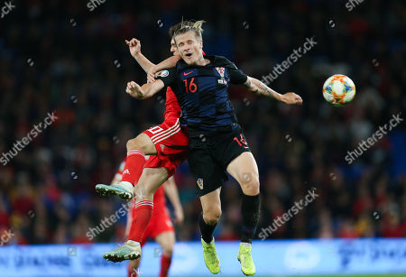 Daniel James of Wales and Tin Jedvaj of Croatia collide as they compete for the ball