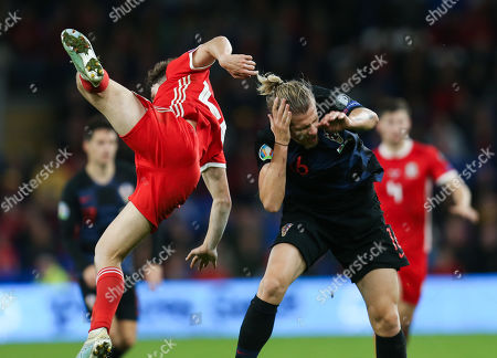 Stock Photo of Daniel James of Wales and Tin Jedvaj of Croatia collide as they compete for the ball