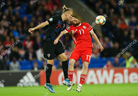 Domagoj Vida of Croatia and Jonny Williams of Wales compete for the ball