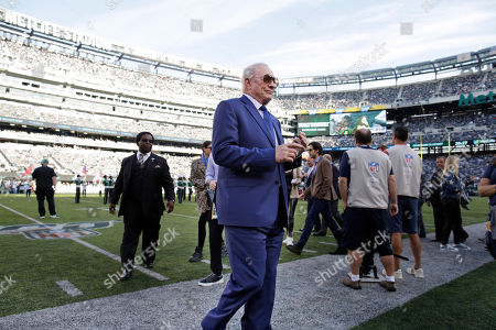 Stock Photo of Dallas Cowboys owner Jerry Jones walks on the field before an NFL football game against the New York Jets, in East Rutherford, N.J