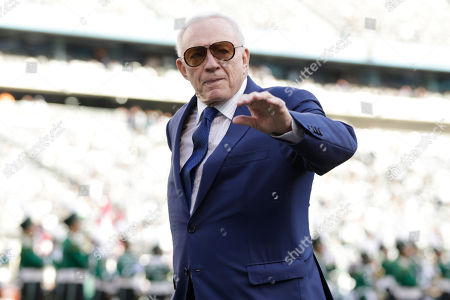 Dallas Cowboys owner Jerry Jones walks on the field before an NFL football game against the New York Jets, in East Rutherford, N.J