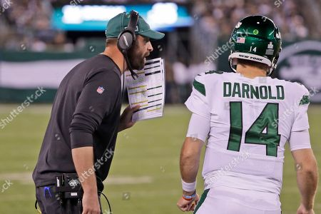 New York Jets head coach Adam Gase, left, talks to quarterback Sam Darnold during the second half of an NFL football game against the Dallas Cowboys, in East Rutherford, N.J