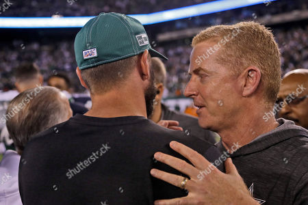 Dallas Cowboys head coach Jason Garrett, right, greets New York Jets head coach Adam Gase after an NFL football game, in East Rutherford, N.J. The Jets defeated the Cowboys 24-22