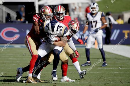 Stock Picture of San Francisco 49ers cornerback Richard Sherman, left, stops Los Angeles Rams tight end Tyler Higbee (89), with middle linebacker Kwon Alexander, right, and strong safety Jaquiski Tartt during the second half of an NFL football game, in Los Angeles