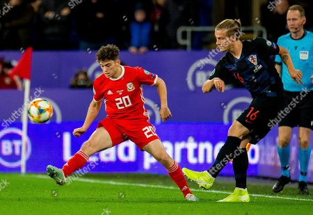 Stock Image of Wales' Daniel James (L) in action with Croatia's Tin Jedvaj (R) during the UEFA EURO 2020 group E qualifier soccer match between Wales and Croatia held at Cardiff City Stadium in Wales, Britain, 13 October 2019.
