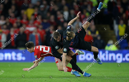 Daniel James of Wales falls to the ground after colliding with Domagoj Vida of Croatia.