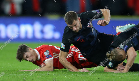Stock Picture of Daniel James of Wales falls to the ground after colliding with Domagoj Vida of Croatia.