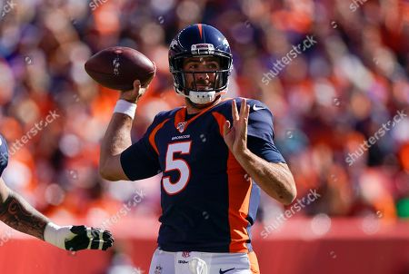 Denver Broncos quarterback Joe Flacco prepares to throw a pass during the first half of an NFL football game against the Tennessee Titans, in Denver