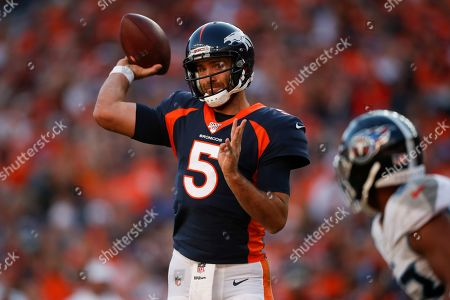 Denver Broncos quarterback Joe Flacco prepares to throw a pass during the second half of an NFL football game against the Tennessee Titans, in Denver